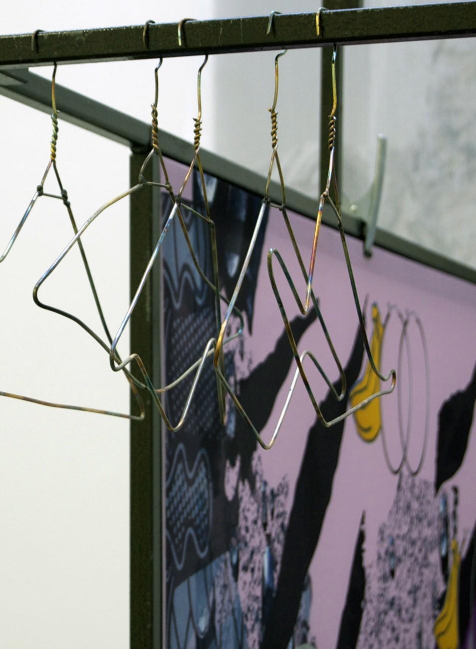 Detail, torched bronze hangers